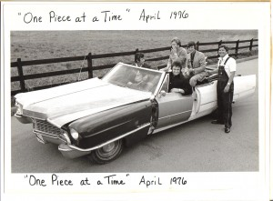 Johnny Cash in the driver's seat of the - One Piece At a Time - Cadillac with Bruce Fitzpatrick standing at the far right.